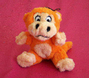 Plush orange monkey pet toy